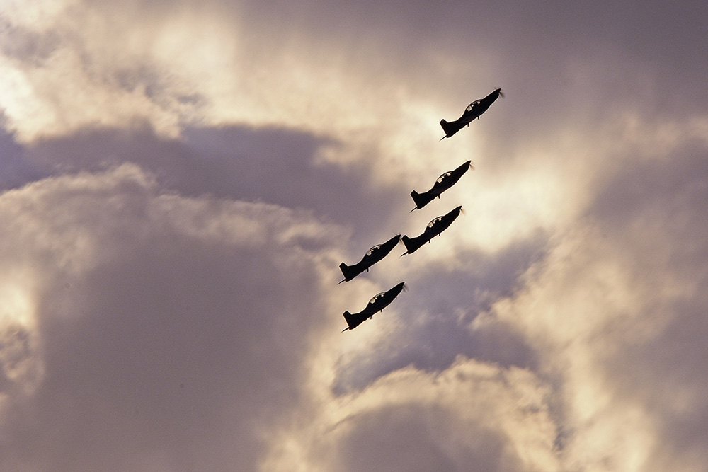 Silver Falcons Aerobatic Team during sunset